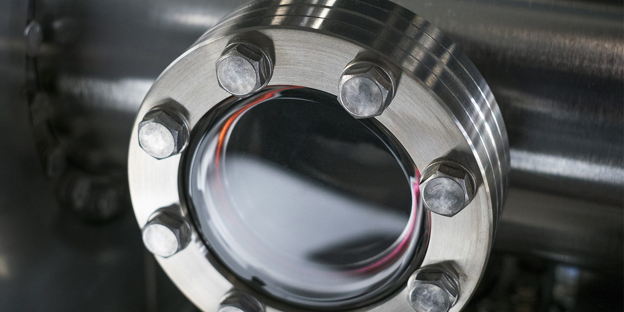 denatec-detail-of-vacuum-equipment-with-steel-flanges-bolted-to-the-vessel-industrial