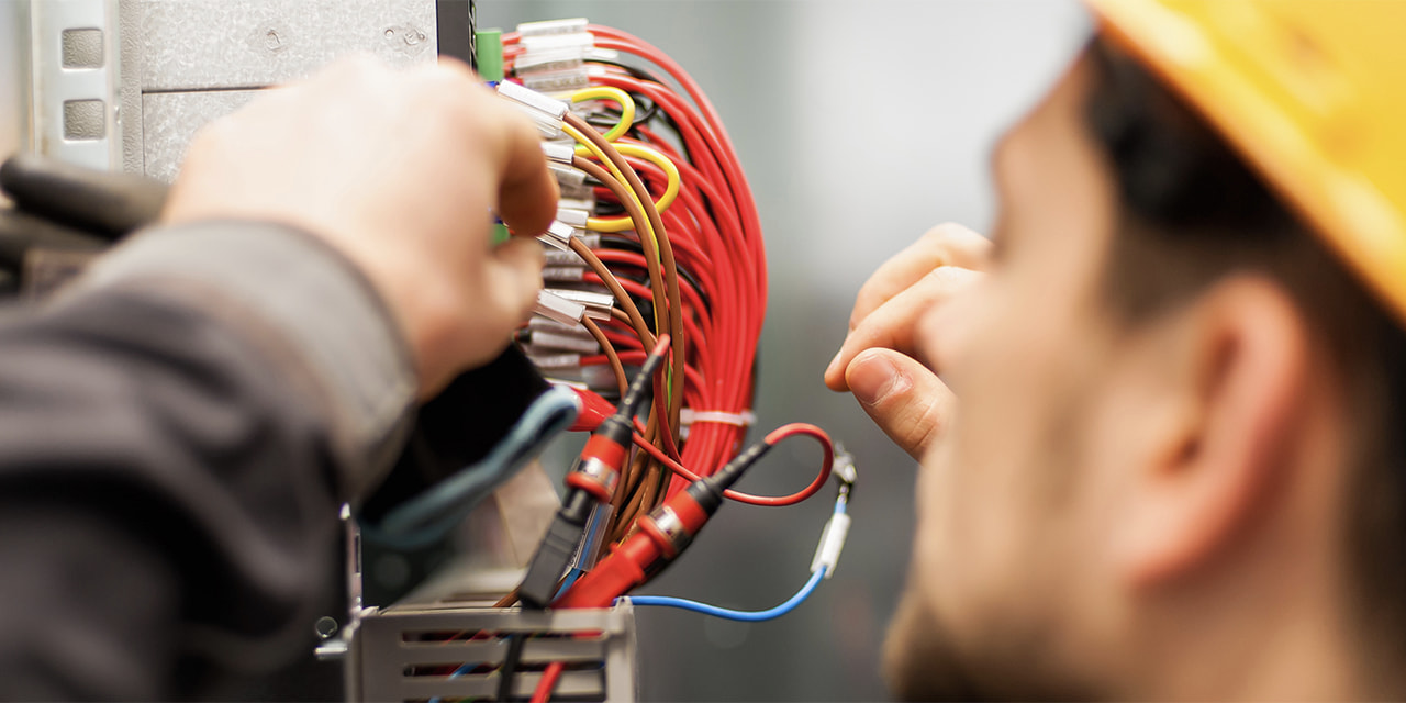 denatec-electrician-engineer-tests-electrical-installations-and-wires-on-relay-protection-system-bay