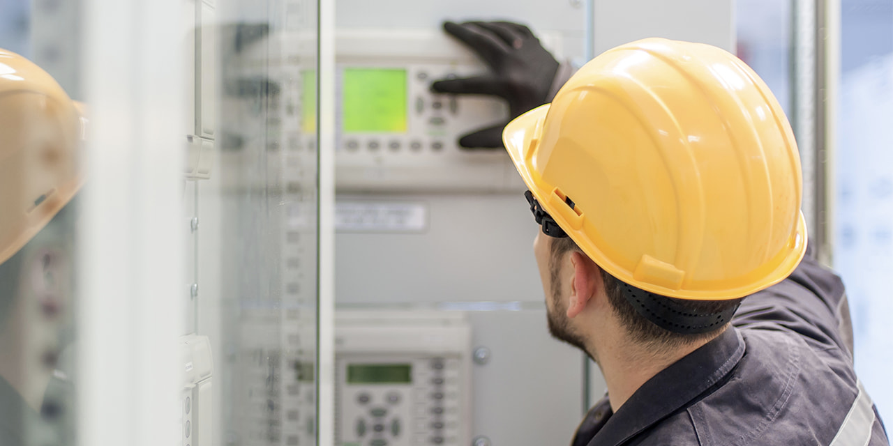 denatec-engineer-commissioning-bay-control-unit-engineering-department-medium-voltage-switchgear