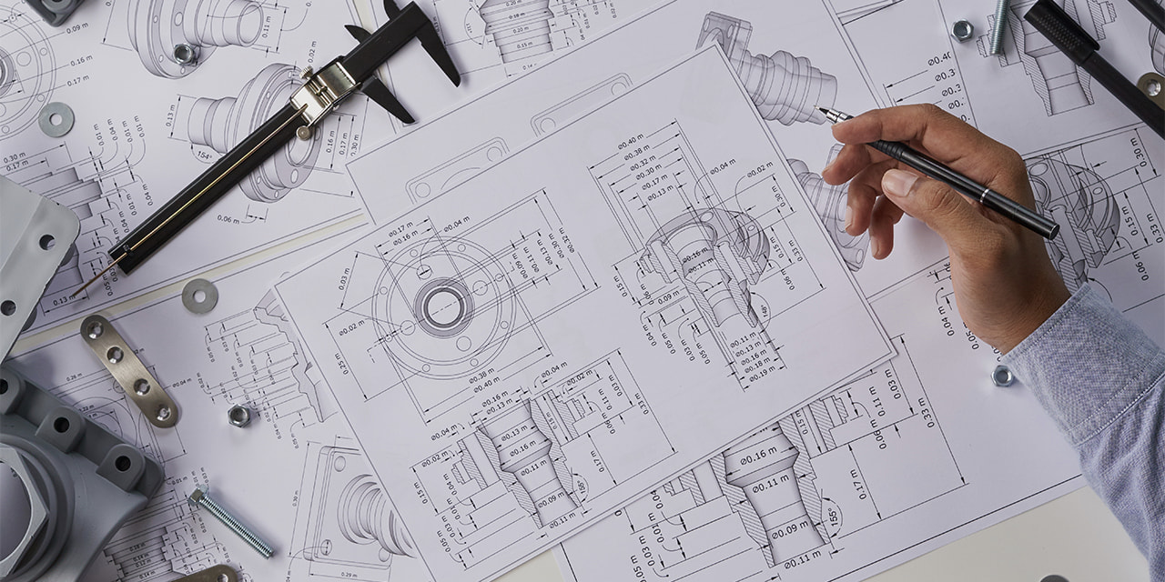 denatec-engineer-technician-designing-drawings-mechanical-parts-engineering-engine-manufacturing-factory