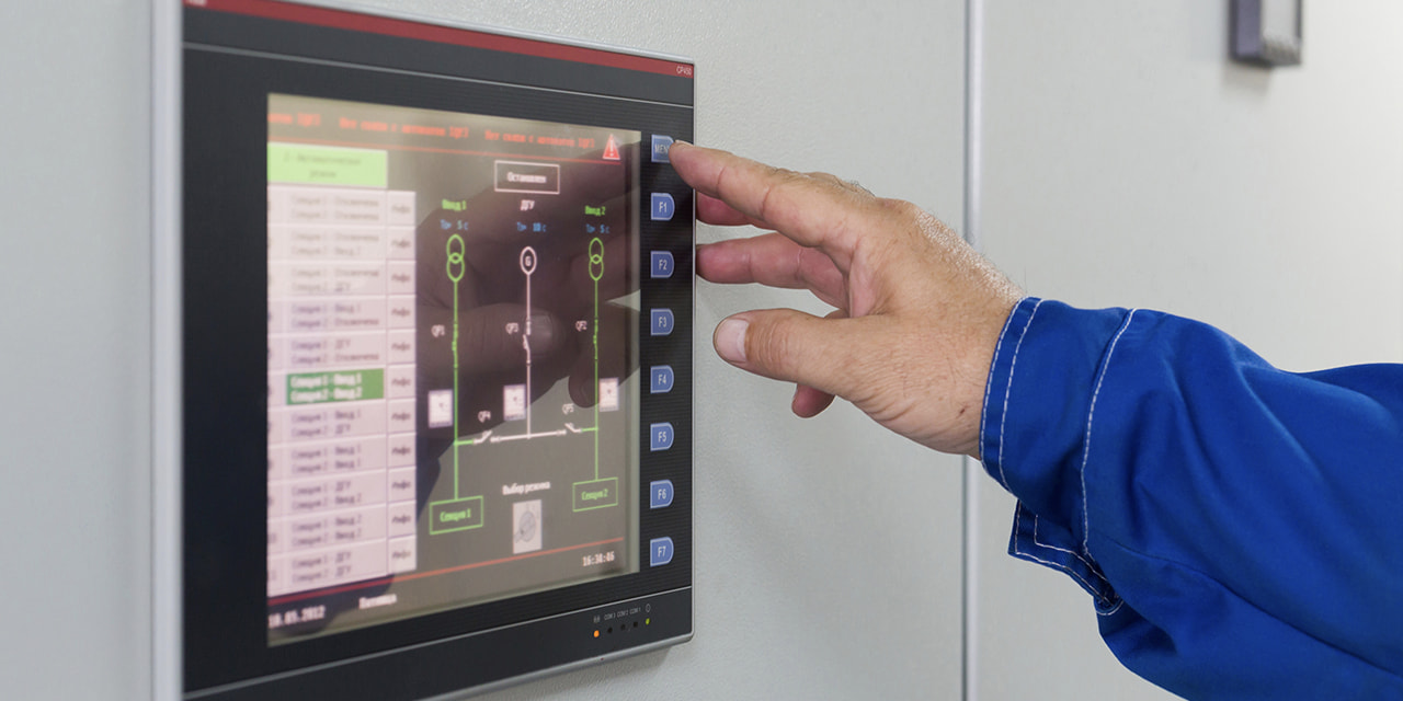 denatec-man-presses-a-button-on-color-screen-control-of-equipment-for-telecom